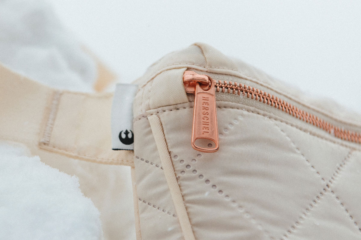 close up shot of the front of the bag showing rose gold zippers and hardware