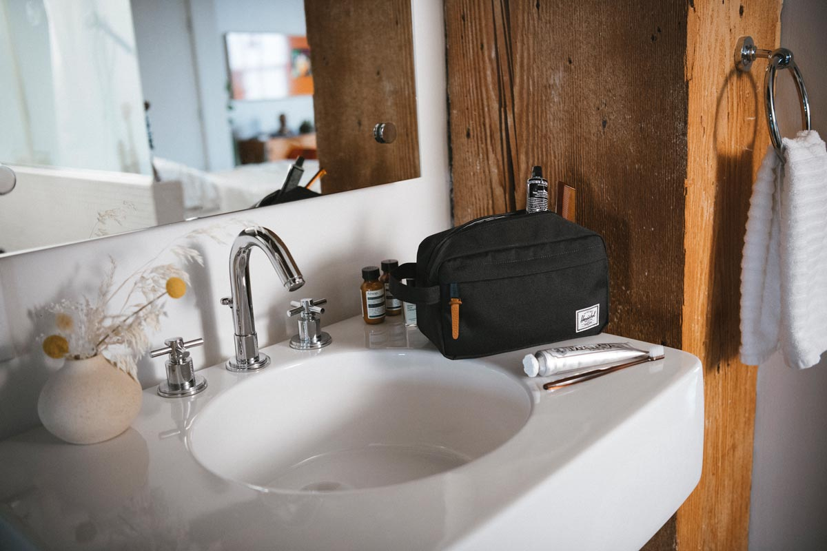 Front storage pocket with pebbled leather pull (standard shown)